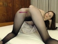 Teen in nylon pantyhose toying her hole